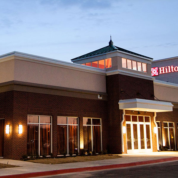 the internet or conduct any needed business activities the exterior of this property is a combination of brick and stucco with a wood and steel - Hilton Garden Inn Lawton Ok
